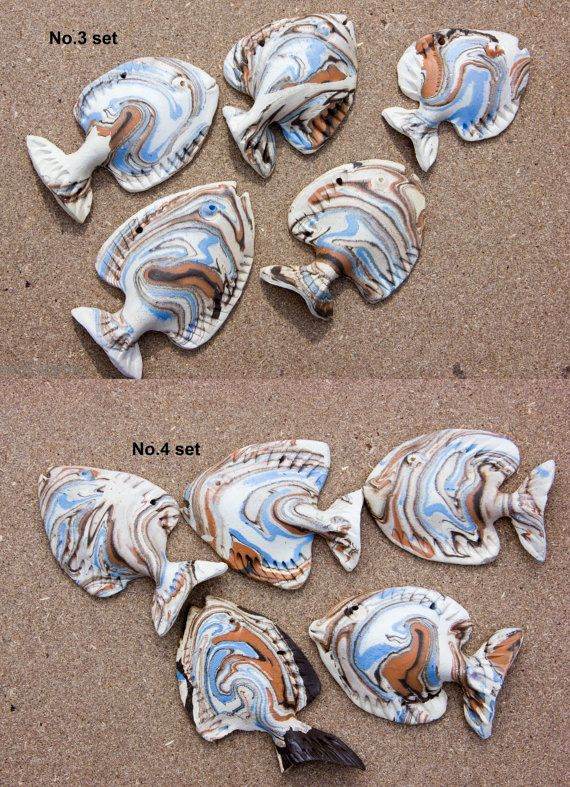 This is set of 5 handmade ceramic fish wall decorations. A school of fish wall art hanging fly fishing decor. It is ideal fit for various interior and exterior as beach lake house, tropical style. It's wonderful Fathers day Gift, gift for fisherman.  Every fish decoration is separate, so you can design your own sea life us you wish. Also every item I made myself, I didnt use any molds for these decorations. These wall decorations are made of natural clay. They are not PAINTED! They are from…