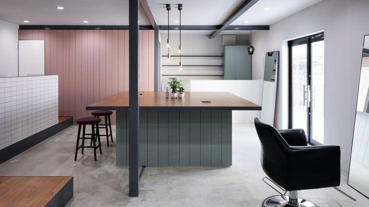 Soft hues and dark framework decorate this compact hair salon in Osaka by Japanese studio Hidenori Tsuboi Architects.