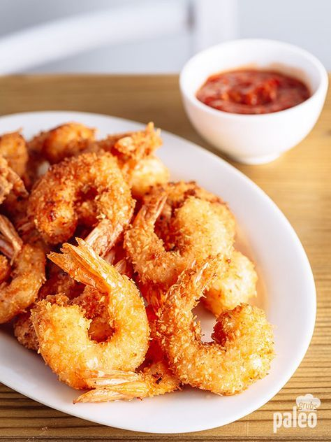 You'll gobble up these Paleo coconut shrimp. A little coconutty-sweet takes the simple shrimp to a new level!