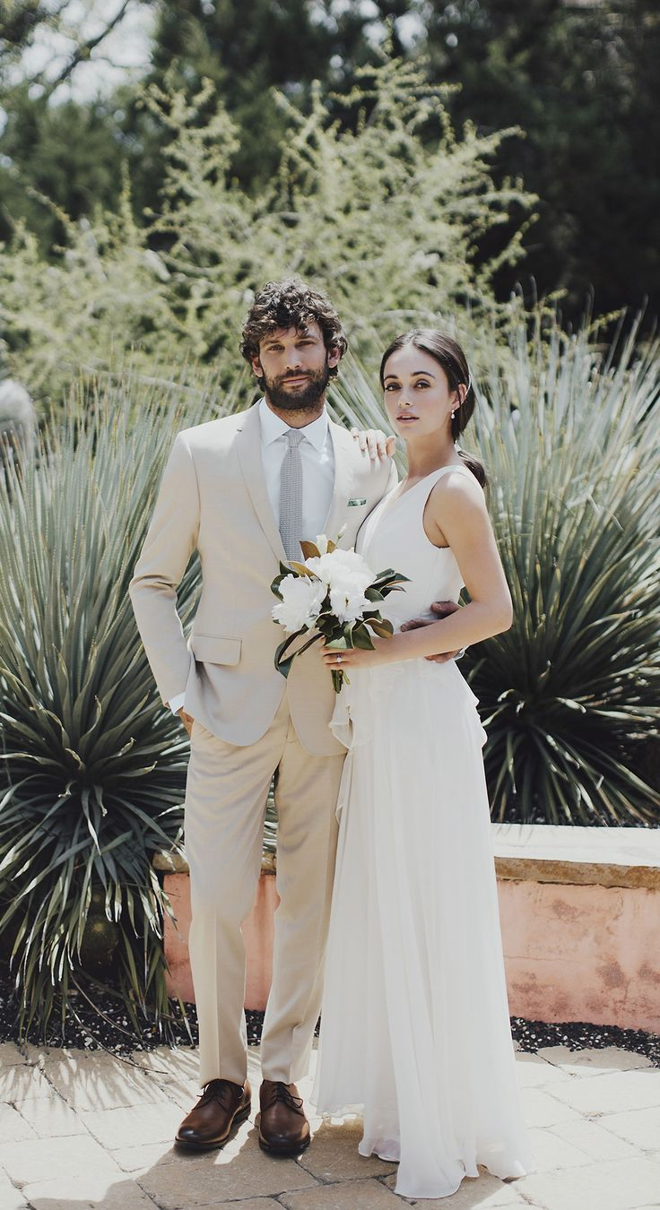 The Black Tux Tan Suit. Dressed it up or down, just perfect for warm weather events. Rent this look and more, hassle free at @theblacktux. #theblacktux #theblacktuxwedding #tuxedo #tux #tuxedorental #groom #wedding #guidethegroom #groomsmen #menswear #groomstyle