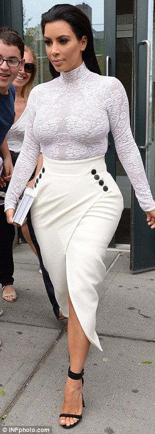 Bootylicious! Kim Kardashian brings in the Spanx to wear tight split skirt morning after fashion face off with Beyonce at Met Gala | Daily Mail Online