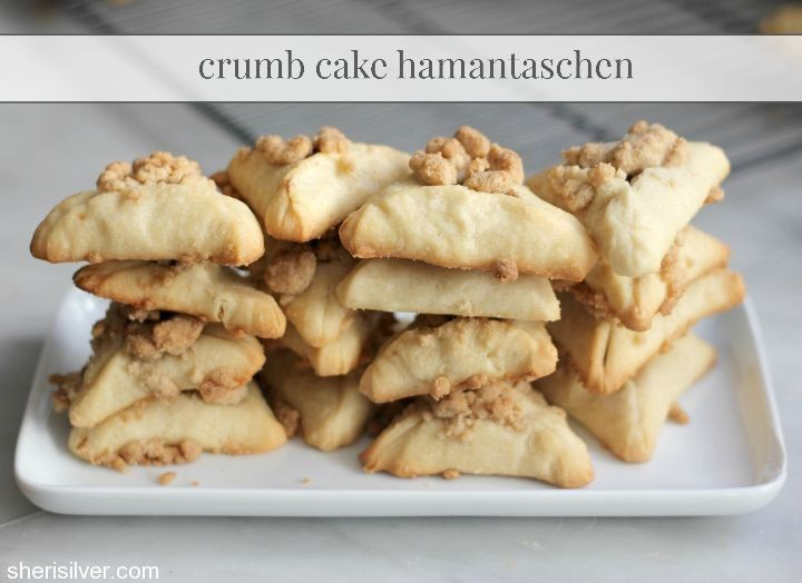 Flaky dough, brown sugar filling, buttery crumb topping AND a drizzle of glaze - it's Crumb Cake Hamantaschen, perfect for Purim!