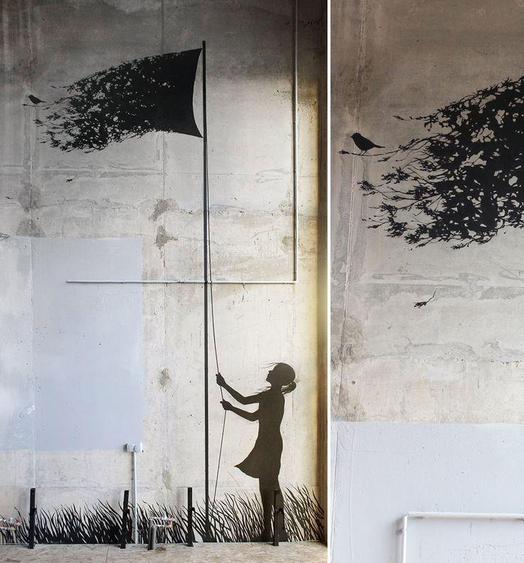 Street-artiste espagnol Pejac, œuvres sur les murs de villes europeennes