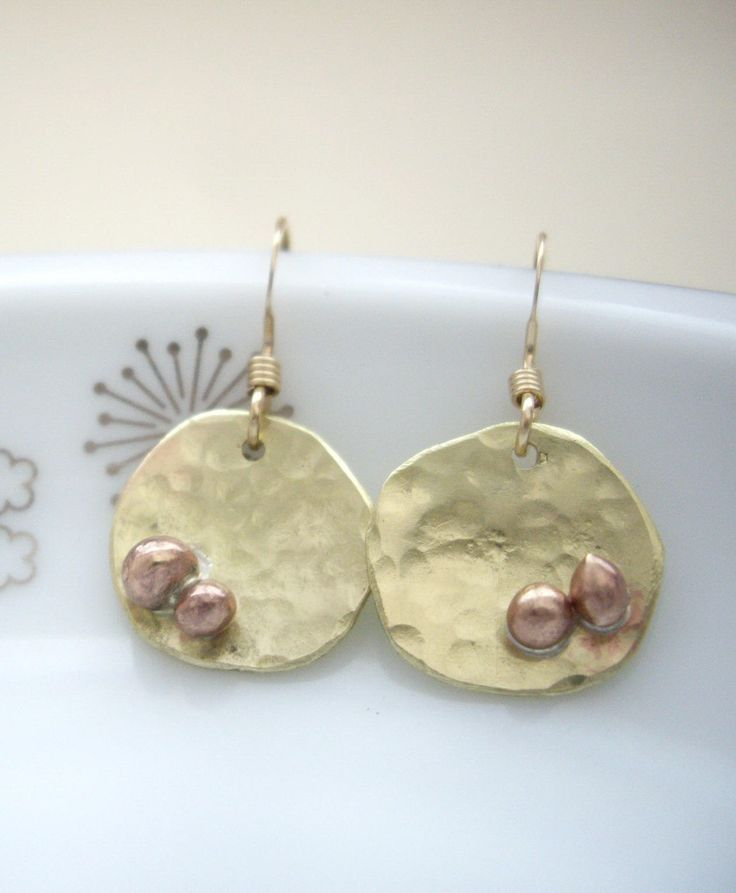 Minimal gold disk short earrings. I cut a disc from a raw brass sheet. I remained hand writing taste. Those discs are textured by hummer and soldered bronze metal balls. Those metal balls add spice on design. Simple and never tiered of design. Good for daily jewelry. *READY TO SHIP. FREE GIFT WRAP. Please leave a note to seller if its for a gift. *Free option to change ear wires to clip on. *Variations are available in the shop. https://www.etsy.com/listing/531747402/...