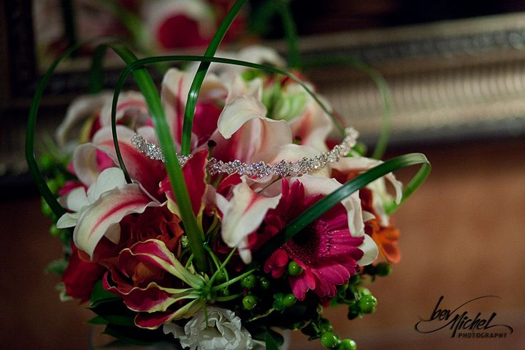 Fragrant stargazer lilies are featured in this architectural bouquet.