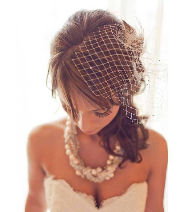 love the birdcage veil, hair, and necklace =)