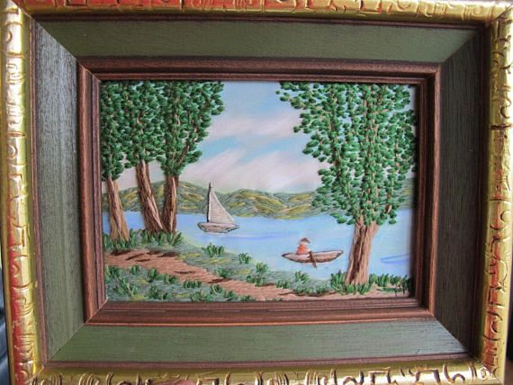 Just a delightful piece of vintage fibre artwork! Look at the beautiful detail of the boats, trees and landscape. Likely a northern Ontario lake view. Crewel work picture on painted fabric (silk?) background. Simply signed PH. Picture size is about 6 3/4 by 4 1/2 inches. Overall size as