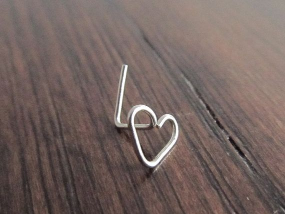 316L stainless steel wire is hand formed into a pretty little heart shape and formed into an l-bend nose stud. This is made using 22 gauge