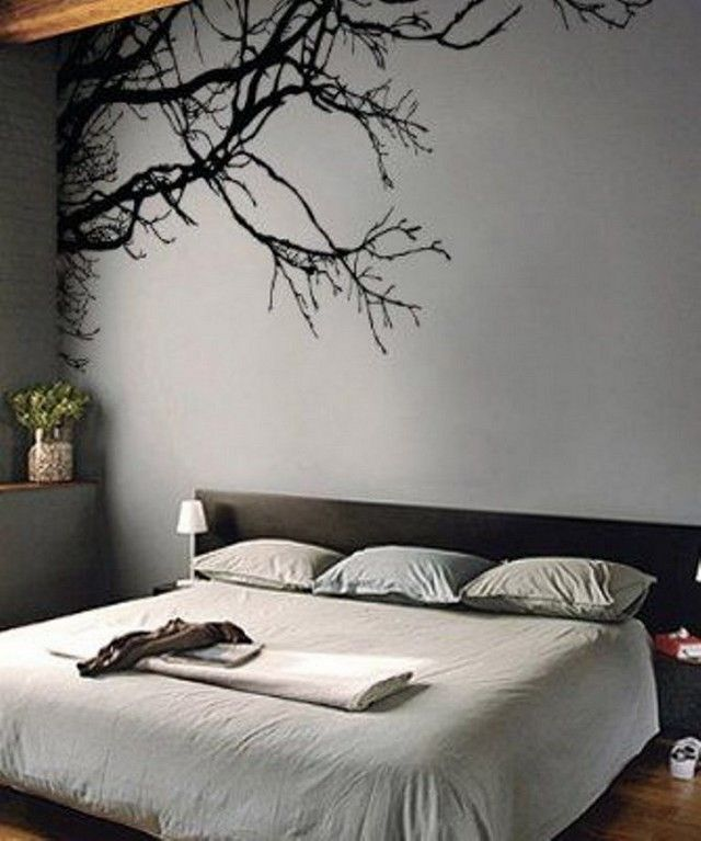Another very smartly done interior décor of the bedroom, with a little wall mural at the back and to enhance overall décor, a plant has been arranged in one of the corners. This is the amazing example of a grey décor that has been made visible to some natural lighting as well for a cheerful environment.