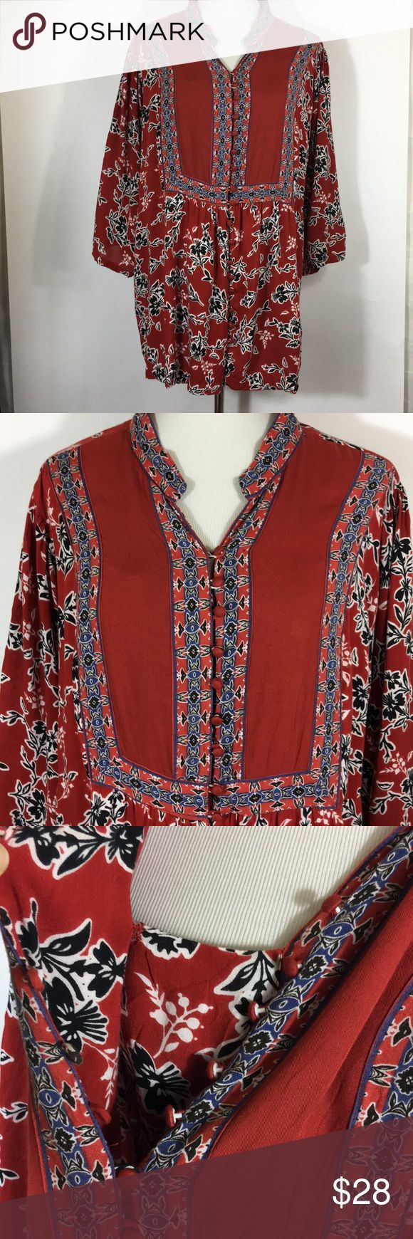 """Plus Size Peasant Blouse 1X 22/24 Flowing Long Top Content tag is missing but it feels like a soft rayon.  Deep warm brick red background with black, white and blue floral pattern  Fabric covered buttons all the way down the front with a modesty panel that snaps behind the placket. If a button comes undone you won't be exposed.  Size 1X 22/24 Woman Within 27.5"""" across underarms  26"""" across at waist 35"""" across bottom hem  30"""" long shoulder to hem Machine washable, air dry Woman Within Tops…"""