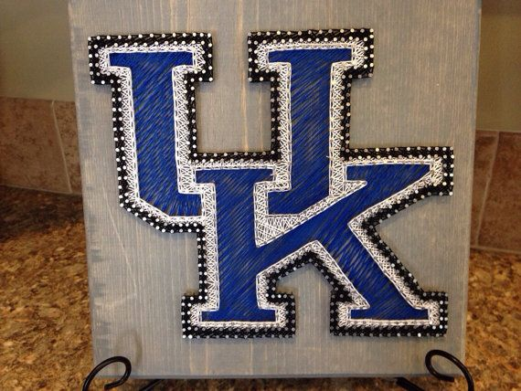 11x11 board featuring UK logo. Great for the UK fan! Board stain can be customized as well as size of logo/board.