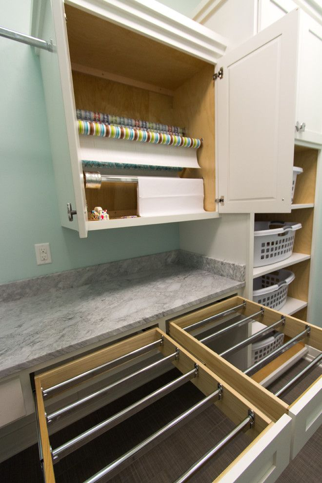Built in drying rack laundry room transitional with white cabinets laundry storage