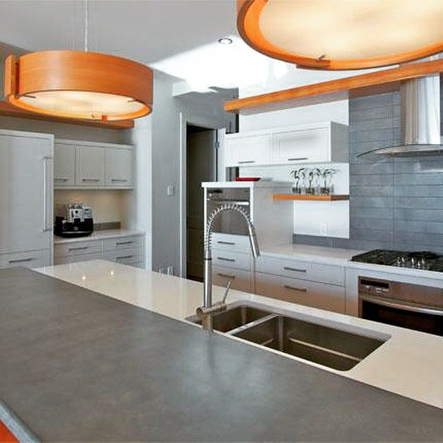 Who would have thought? Concrete countertops! #kitchendesin #kitchens #homedesign #design #interiordesign #sinks #lights #decor #house #home #wood #concrete #whitekitchen #modern #contemporary