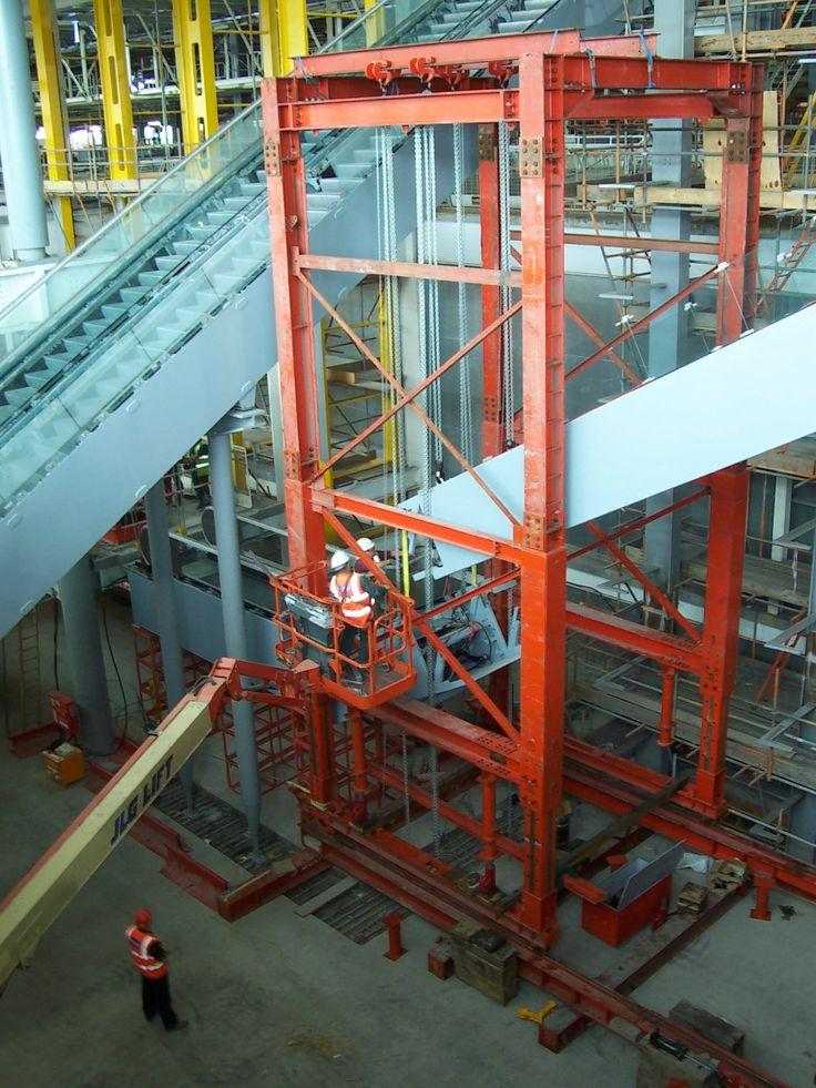 Experts at precison lifting. Beck & Pollitzer operatives transport and safely install Heathrow T-5 escalators.
