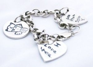 Charm Bracelet featuring your children's artwork, scribbles, or messages.  A beautiful piece of jewellery that can be added to over time. Prices start from £94.