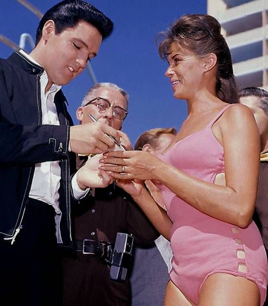 Elvis with fans between takes on the set of his movie Viva Las Vegas in the summer of 1963.