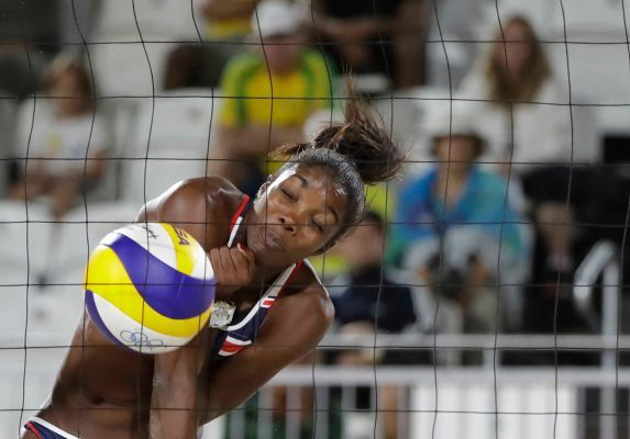 Costa Rica's Karen Cope Charles hits against Netherlands during a women's beach volleyball match at the 2016 Summer Olympics in Rio de Janeiro, Brazil, Monday, Aug. 8, 2016.