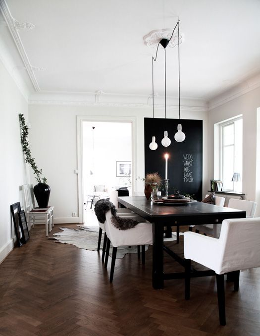Love.  Dark wooden floors, chalkboard accent wall, hanging lights, black and white.