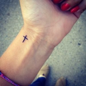 Totally love this ams the placement, love this little guy #cross #tattoo