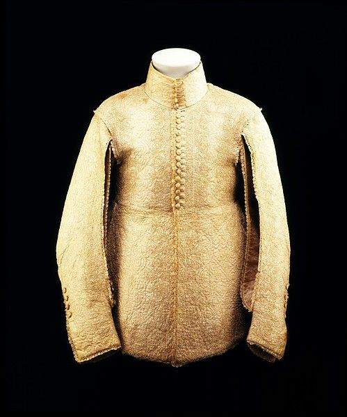 A doublet of the late 1630s had a waistline at the natural level with large flaps or tabs, as they were known, falling below. Typical of the period, are the back seam and seams of the sleeves. They have been deliberately left unstitched to allow the billowing shirt to show through from underneath. Fashions of the 1630s featured a high collar over which the falling band of fine linen and lace could drape becomingly.