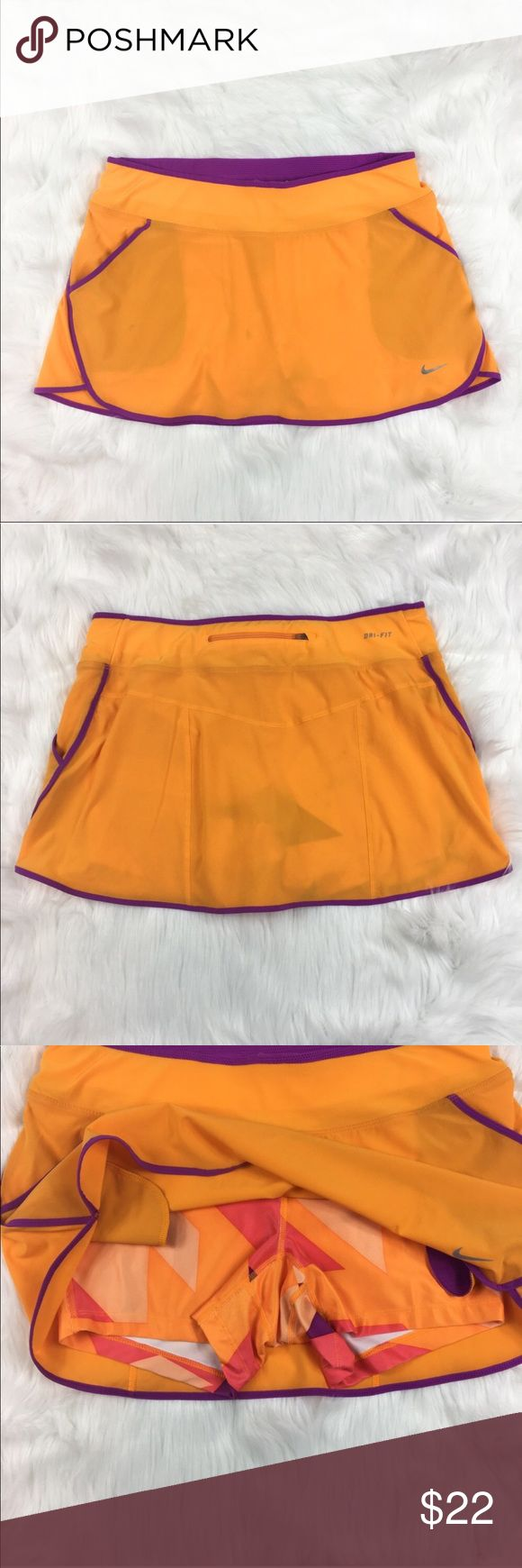 Nike Dry-Fit Skort Nike Running orange & purple dry-fit skort. Size medium. Pre-Owned conditon. Had stain as pictured. Has multi colored compression shorts underneath. ❌I do not Trade 🙅🏻 Or model 💲 Posh Transactions ONLY Nike Shorts Skorts