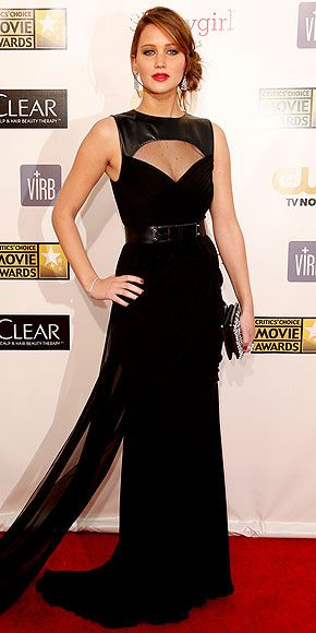 Jennifer Lawrence in a black gown with leather panel, draping at the hips and a sheer train at the Critics' Choice Awards