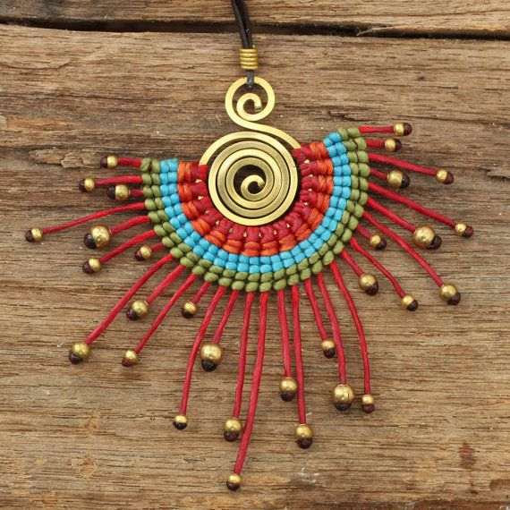 Tribal designs necklace in red orange and blue waxed cotton cord with brass highlights
