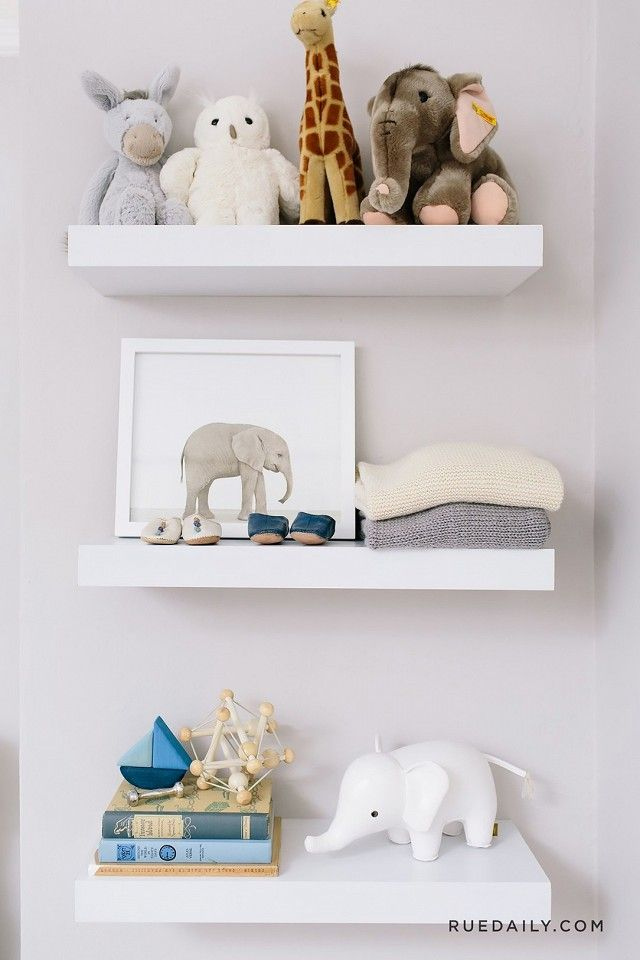 A well-styled shelf inside a gender-neutral nursery