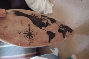 This design is simple, but it is very appealing. The map of the earth is properly fit to the board and the shape of the board. The asymmetry of the maps location on the board creates a stronger image.