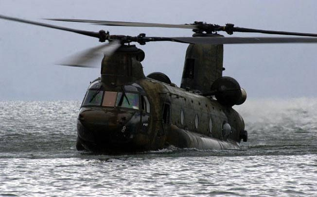 Dropping low enough in the water to allow a zodiac with a platoon to drive it right into the cargo bay.....trick is being able to judge how much water you have onboard....too much and you are staying there.