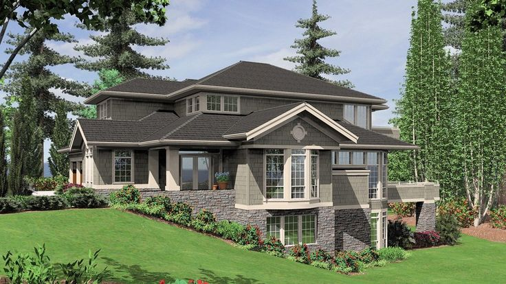 Luxurious Design with Circular Staircase. Plan 2423 The Mendon is a 5209 SqFt Craftsman, Shingle style home plan featuring Covered Patio, Den, Formal Dining Room, Games Room, Library, Loft, Shop, Skylights, Walk-In Pantry, and Wet Bar by Alan Mascord Design Associates. View our entire house plan collection on Houseplans.co.