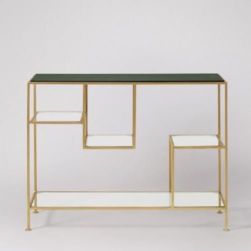 The Lottie console table in white marble. Make an opulent hallway impression with this solid marble and brass-clad beauty. The Lottie's tempered glass shelves are suspended at different heights for accessible and elegant storage, with a slab of green marble on top striking a distinctive Deco note.