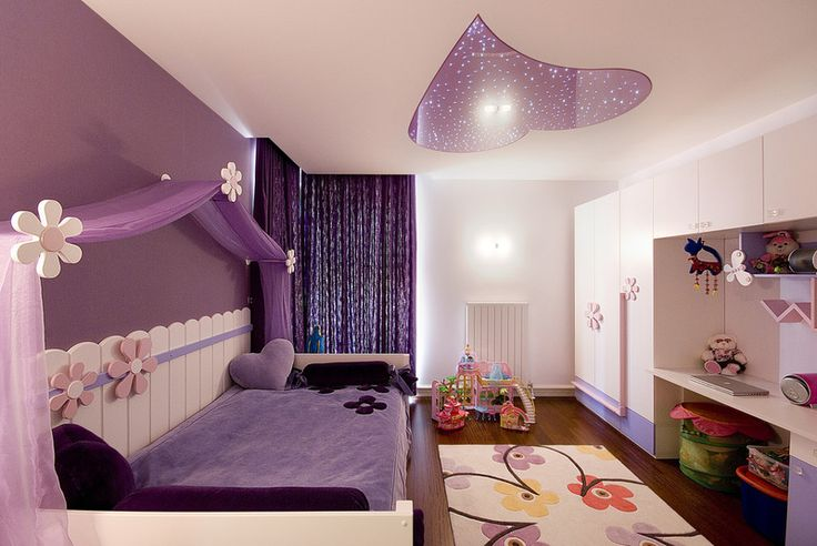 "A combination of a matt and lacquer stretch ceiling in a girl's room. The form of heart is made of a purple stretch foil together with ""Starry Sky"" effect."