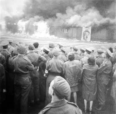 Bergen-Belsen, Germany - Survivors and liberators watching the Nazi concentration camp burn. The camp was liberated on April 15, 1945 by the British 11th Armoured Division.