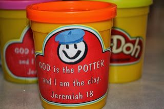 with the small play-doh cans
