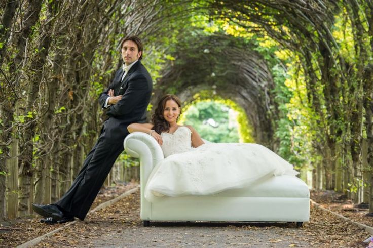Bride lounging on couch under the vined overpass at Celebrate at Snug Harbor in Staten Island, NY