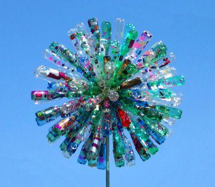 dandelion sculpture turns in the wind