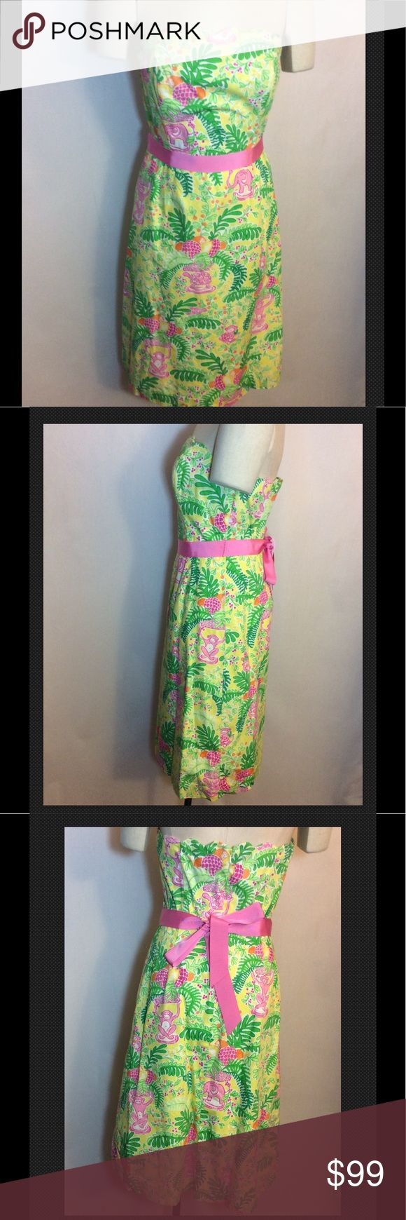 """Lilly Pulitzer Touchy Feely Yellow Strapless 8 EUC Lilly Pulitzer Touchy Feely 2012 Yellow Cotton Strapless Size 8 EUC Such a happy shade of yellow with hot pink and hades of green, white and orange. The body is 100% cotton lined in a poly Cotton Blend.  Strapless with a scalloped top and silicone banding to hold it up with boning at sides. Wide pink ribbon tie and zipper 11-1/2"""" long in the back. It is a size 8 and measures 27"""" at empire waist, 4"""" at the chest and 32"""" long measured in back…"""