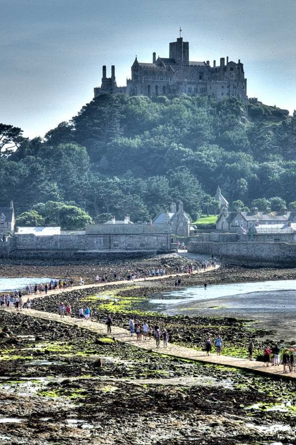 Walking on the causeway to St Michael's Mount, Cornwall, UK