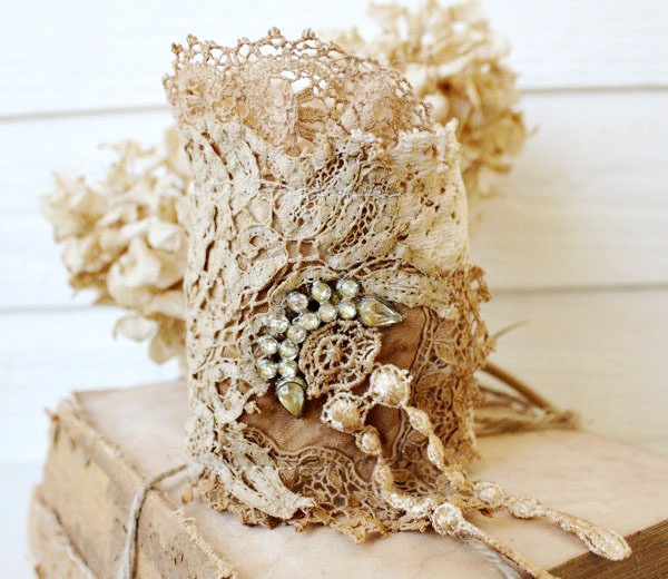 Vintage lace bits covering candle  (Then use it for a bracelet)