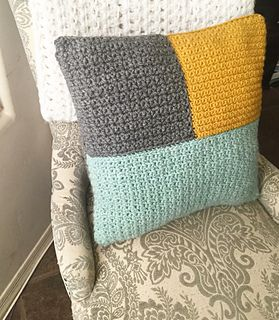 This is a fun and simple pattern for a color block pillow. There is only one stitch to know and it works up pretty quickly. The beauty of this pattern is that you can use a variety of yarn weights. Your goal is to achieve a set width and height for each block to create an 18×18″ pillow. I used Patons Classic Wool Roving in Low Tide, which is a bulky weight yarn and then doubled up my gray and mustard Lion Brand yarns because they were worsted weight.