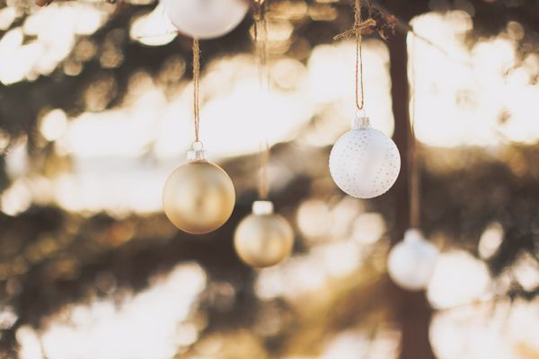 Hang Christmas Ornaments From Twine on deck, under deck