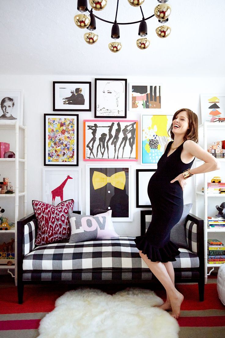 Coco Rocha in her daughter's pattern-packed nursery with large gallery wall and modern chandelier
