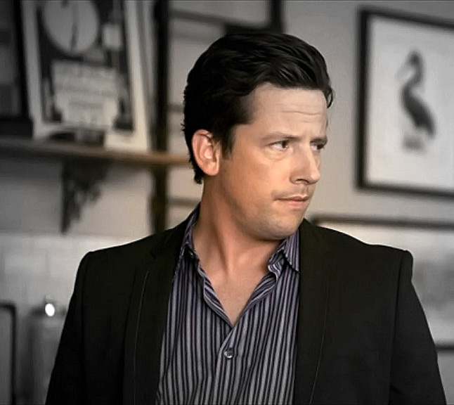 Matthew Keller (Ross McCall) in Neal's apartment. (White Collar: Checkmate)