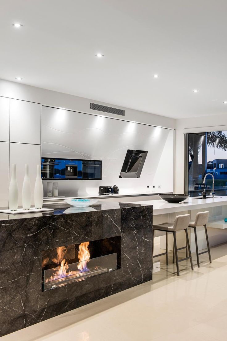 Enigma Interiors went above and beyond in this waterfront space - from the eclectic kitchen design to the open plan living area