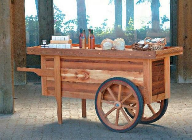 My wife and I are vendors at the local farmer's market and I designed this cart as a way to display our wares.