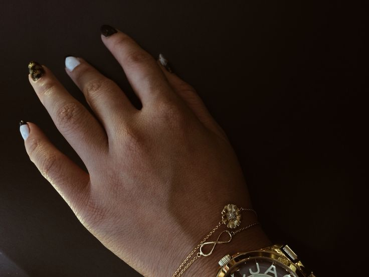| Gold statement watch matched with our fine gold pieces |  #jewellery #jewelry #bracelets #infinityjewellery #infinity #friendship #daisybracelets #floral #handcraftedjewellery #handmade www.pinchandfold.com
