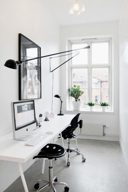 clean and clutter free office and great way to handle a challenging linear space
