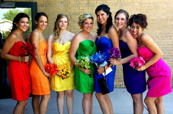 Rainbow bridesmaids. i would have an actual purple and no pink