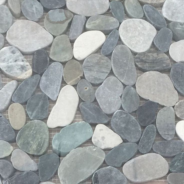 """""""We chose this pretty pebble tile from @loweshomeimprovement for our shower…"""